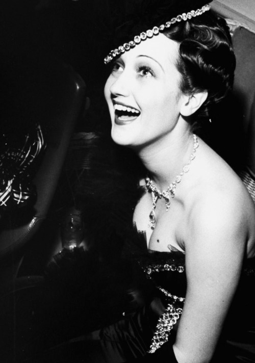 "anantoinetteaffair:   Dorothy Lamour attends Edgar Bergen's ""Gay 90's"" party in Beverly Hills, photographed by Peter Stackpole, 1939."