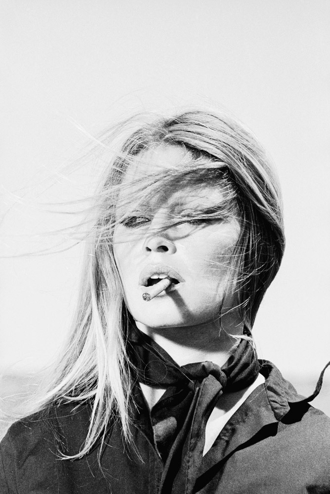 timelightbox:  Terry O'Neill—Getty Images French actress Brigitte Bardot smoking a slim cigar while in Spain, 1971. TIME's All-TIME Top 100 Fashion Icons launched today, and it includes listings for the most influential fashion photographers and muses of the past century. See more here.