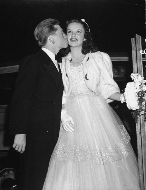 life:  Mickey Rooney kisses co-star Judy Garland at the premiere of Babes in Arms in 1939. The two starred in nine movies together, among them the popular Andy Hardy series. (see more photos here)