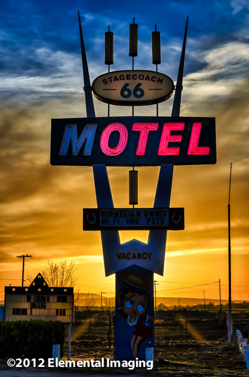 Sunsetting behind the neon sign at the Stagecoach 66 Motel, Seligman Arizona, west of Flagstaff on old Route 66.  Definitely a place that revels in the history and legends of the old Route.