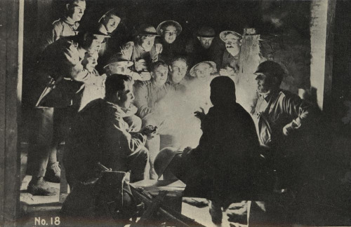 Taking a break from the battlefield, chatting around the campfire, ca. 1917  Photographer: James Francis (Frank) Hurley Location: Steenvoorde, France Description: Part of Our Boys at the Front series of postcards, no. 18. From official photographs by special permission of the Department of Defence. Proceeds to the Australian Comforts Fund. (Printing on verso of postcard). Original photograph taken by Frank Hurley and is in the Australian War Memorial.