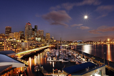 theworldwelivein:  Moon Rising over the Seattle Waterfront (by David M Hogan - Now on Google+ too)