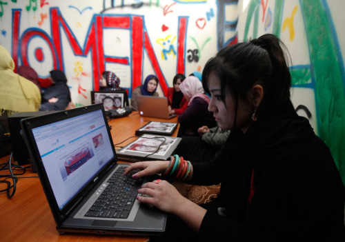 Afghan girls work at the first Internet cafe for women in Kabul, on March 8, 2012. Afghanistan recently opened its first female-only internet cafe, hoping to give women a chance to connect to the world without verbal and sexual harassment and free from the unwanted gazes of their countrymen. (Reuters/Mohammad Ismail)