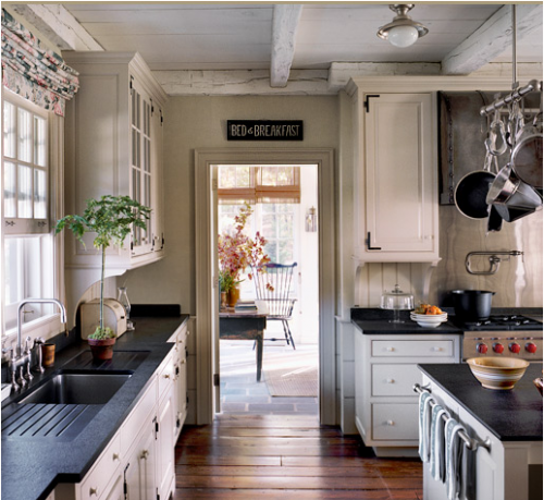 seersuckerandmagnolias:  The exposed beams, iron hinges, and Windsor chair are making my heart flutter.  That's a fine looking chair, but so is that Wolf Range.