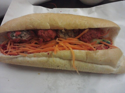 Straight from Banh Mi Sao Mai, a combo meatball and shredded pork banh mi. Also called a Viet po boy. French bread, pickled shredded carrots, cucumber, bbq pork (which I recognize as cha shao), meatballs that are red on the outside too (prepared in a similar way as the pork I guess). Very tasty and at a great price point.Upon reading the wiki article, it seems that the red could come from red food coloring. It is traditionally from red fermented bean curd. I thought it was from being smoked as in American BBQ. Guess I was wrong! Thanks to Vi for bringing them to class for us!