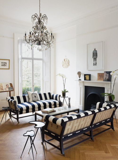 The details in this room: That cushion. The side tables. The chandelier. Nice!