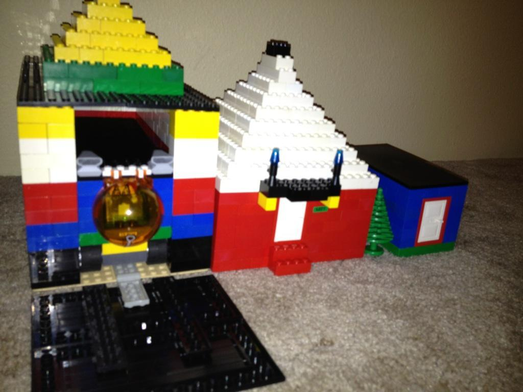 Garage…house…shed and a car in the garage All made from legos I need new freinds (X