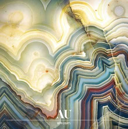 "AU+Both Lights Cover art and track listing revealed for AU's new album, Both Lights, out April 3 on Hometapes. tour dates announced, including SXSW & shows with The Dodos, Deerhoof, & more. MP3: AU ""Solid Gold"" (from Both Lights & Solid Gold 7"") AU Both Lights Epic Get Alive Crazy Idol OJ The Veil Solid Gold Today/Tonight Why I Must Go Slow Old Friend Don't Lie Down Both Lights hit me like a wave. I walked right into it, eyes open. The music writer Bob Palmer once described ""a fusion of music and poetry accomplished at a very high emotional temperature."" He called it ""a gigantic field of feeling…something enduring, something that could be limitless."" Palmer was talking about the Blues. But all I can think about is AU. Like all waves, it keeps on coming. AU's third album, Both Lights, is a recurring dream. Eleven songs made by the Portland, Oregon-based duo Luke Wyland and Dana Valatka, it's a story of Time. Three years to be exact: since their critically-acclaimed 2008 album Verbs and its 2009 EP evolution Versions, there's been a long exhale. A little defiance of the double-speed countdown of the indie hype clock. And a hell of a lot of living. Turn it on. More than a mere accompaniment, it's a gleaming mirror. It's an exaltation, an exhalation, a monument of extreme composition, the child of collaboration and isolation, a preamble to a wild live show, a statue intact in the violent wind of art and commerce, and, simply, a record about love. It's for itself, and, in being that, it's an album that can be understood like a person. ""It's the topography of me,"" says Wyland. So you follow the coordinates. The record begins with ""Epic"" — count it among the world's greatest lead tracks. Complete with earth-cracking saxophones by man-machine Colin Stetson, ""Epic"" defines ascension — from the slow motion of an Oregon sunrise to a '67 Barracuda barreling off a bridge. It's a thesis statement for an album that began as a series of improvisations in Wyland's attic, a one-man tug of war with love, loss, pain, anger, and desire. Wyland calls ""Epic"" a ""real re-introduction to the band"" and it encompasses that extreme confidence. It sets the tone for Both Lights, illuminating the frantic energy that drives AU."
