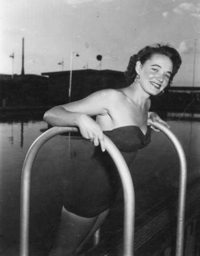 Beryl Mason modelling swimwear at the Mount Isa swimming pool, 1954