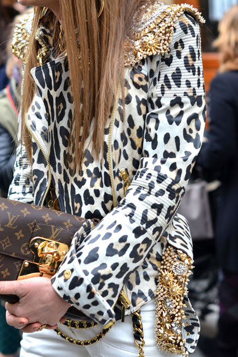 Leopard biker leather jacket & LV clutch.