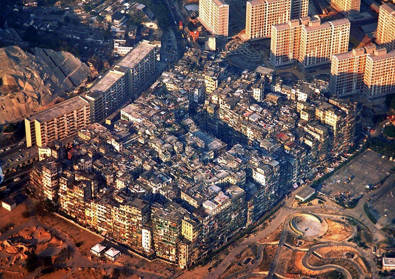 A STUNNING view of Kowloon's once infamous 'Walled City' - home to Triads, drug criminals and the most densely populated plot of land in history (33,000 people on 6 acres).