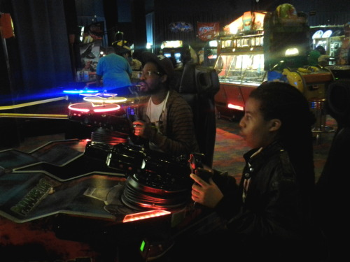 Husband & son having fun @ Dave & Buster's