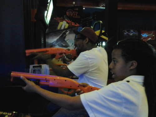 Husband & son duck hunting @ Dave & Buster's