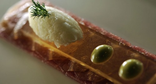 "Tuna Carpaccio with Daikon and Wasabi Emulsion, courtesy of Singaporean chef Jusman So of AYANA Resort and Spa Bali's Dava Restaurant. For the recipe, click here. This elegant carpaccio with nori-braised daikon, wasabi emulsion, and yuzu-marinated daikon requires multiple steps but is simple overall.  ""The food world is divided on tuna, - writes the food author of The Daily Meal. - ""While it's difficult to wade through all those health and environmental concerns, the fact remains that tuna is one of the most versatile and palate-friendly fish on the market. Sold fresh or in a can, eaten raw or grilled, tuna is simple to prepare and pairs well with the flavors of many different types of cuisines, from Italian to Japanese to Mexican"""