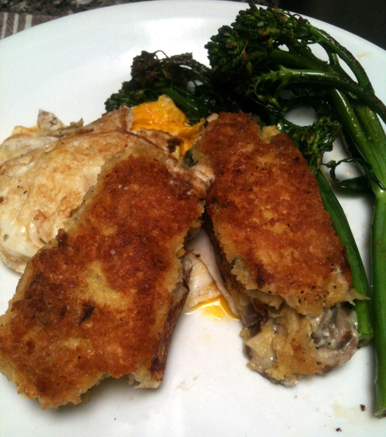 Breakfast: Slices of fried lasagna, eggs, and baby broccoli.  Noms.