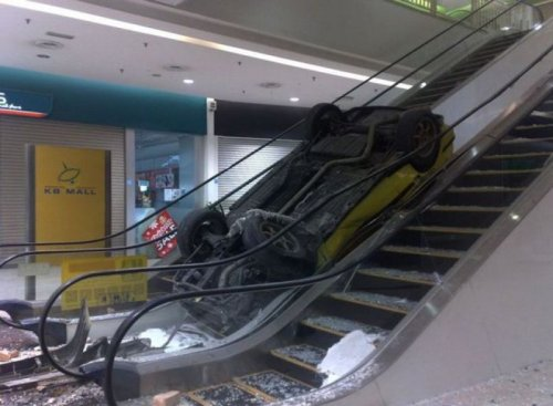 Car Crash on Escalator   If you know a better way to get a car upstairs, I'd like to hear it.
