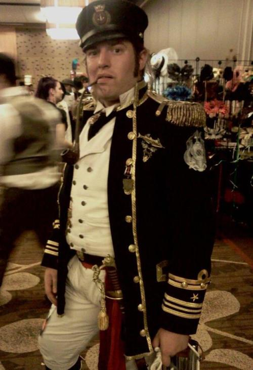 Christoper Sorensen-Black of Seattle modelling a steampunk officer's uniform made up of pieces from various armies and eras. Also a really nice snarfblat.