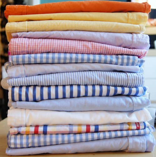 Laundry: Fold and Stack Orange broadcloth, yellow broadcloth, yellow gingham, purple gingham, pink gingham, blue gingham, blue pencil stripe, blue bengal stripe, royal block stripe, blue twill, white twill, primary gingham, blue gingham, blue fine twill