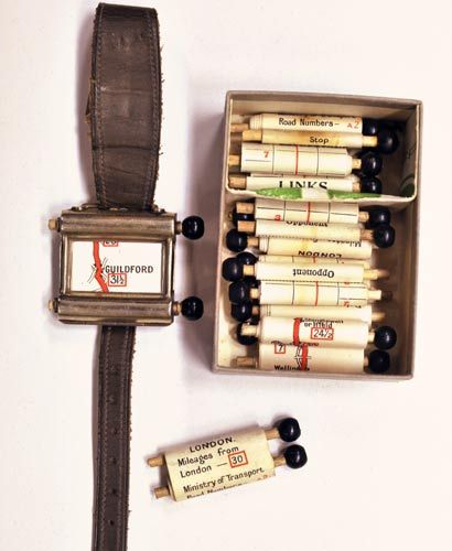 "Real world steampunk GPS system called  'Routefinder'  from the 1920s. I want one of these so I can read Kerouac's On the Road in it's original form. ~ eP slavin:  via Greenfield: ""This fantastic contraption, called the 'Routefinder', showed 1920s drivers in the UK the roads they were travelling down, gave them the mileage covered and told them to stop when they came at journey's end. The technology – a curious cross between the space age and the stone age – consisted of a little map scroll inside a watch, to be 'scrolled' (hence the word) as the driver moved along on the map. A multitude of scrolls could be fitted in the watch to suit the particular trip the driver fancied taking."" (via 314 - Watch the Road: World's Earliest SatNav 