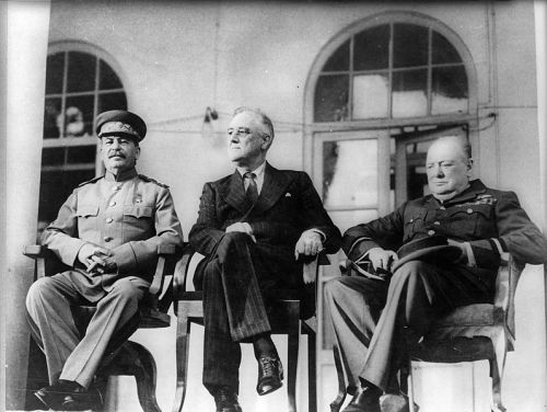 From left to right: Joseph Stalin, Franklin D. Roosevelt, and Winston Churchill on the portico of the Russian Embassy during the Tehran Conference, 1943