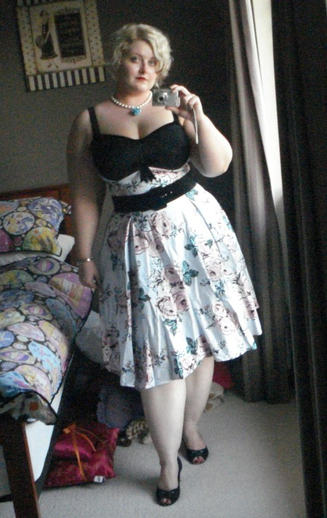 pearlconcubine:  Pinup Girl Clothing Courtesan Swing Dress - size 2X I am so in love with this dress.  I've lusted over it since I saw a preview of it on the Pinup Girl facebook page and have been patiently waiting for it to be released ever since.  I was not disappointed.   The fabric is lovely and thick, the photos don't really do the colours in it justice; the bust panels fit perfectly without cutting my boobs in half and the construction is very high quality.  It is honestly like this dress for tailored for me it fits so well.   There are a few little details I should list since they don't really shop up on the camera.  The bust panel is covered in lace, the inside of it is a very soft satin, it feels like charmuse.  The straps are velvet as is the belt which came with it and the straps are also adjustable.  I desperately need a fancy party to wear this to now.  Tegan, this is perfection!! You (and another lovely friend of mine) have totally sold me on this dress, and as you know I wasn't crazy about it before. I thought it was nice, but not a must have. But seeing the fan photos of it - particularly yours and my friend's - I must have it now. The only question is, do I get it in Victorian Rose or Gingham?