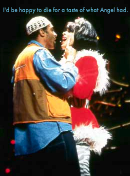 "Image: Angel and Collins from the musical ""Rent.""  Text: ""I'd be happy to die for a taste of what Angel had."""