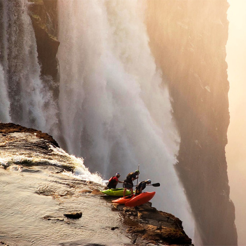 EXTREME KAYAKING This gang of daredevils are probably not going to go over the edge in their kayaks, which would inevitably end in a swift, and watery death. However, I'm not questioning their cojones given that they have kayaked near the edge of a 120m drop to get there. Nutters.