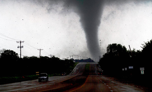 Photograph: Parrish Velasco/AP A tornado touches down and brushes up swathes of debris in Lancaster, Texas, south of Dallas - see more images in our gallery