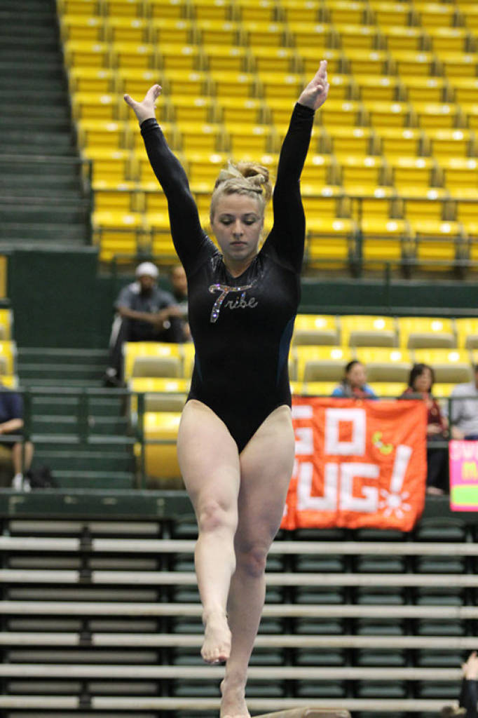 Interview With Brandy Stover-a freshman gymnast from New Albany Indiana who recently won the Beam at the ECAC Championships. Kris Yeager: Congratulations at the ECAC championships! How did it feel to get first place on the Beam as a freshman? Brandy Stover: It was exciting and definitely unexpected. I felt really good being able to represent the Tribe like that. Kris: What was your mental preparation like before the beam? Do you get nervous?  Brandy: I don't really get nervous because I do a lot of mental sets beforehand. So it's just another beam routine.  It's not a big deal (laughs). Kris: Can you go through your work out schedule for a typical practice and week?  Brandy: Yeah we just come in and get warmed up and we normally have three events each day. So we go to that event hit our assignment. When we get done we do conditioning then hit the training room. And we workout three and a half hours a day five days a week. Kris: What motivates you to go into the gym everyday? Who or what do you draw your inspiration from?  Brandy: Motivation-I think is just automatically there because gymnastics is something I've always done and always loved. Inspiration-I think is kind of the same deal. I'm where I wanted to be my whole life doing college gymnastics. That draws me through each practice. Kris: Do you have a favorite gymnast of all time? Why? Brandy: I do. It's someone hardly anybody knows because it's a girl I grew up watching. She graduated and went to West Virginia and came back and coached me. Her name was Jennae Cox. Kris: So your younger sister will be coming to William and Mary next year as I found out. How do you feel about that? How have you and your sister bonded over gymnastics? Brandy: Well, for one I'm really excited. I'm so glad she chose to come here. And bonded…I guess the fact that we spent all that time there [the gym] not only just practicing but we also worked there together and my whole family's involved. I think it just made us closer. Kris: How has your family been involved in gymnastics? Brandy: Well, my two sisters and my little brother both do it. My mom coaches, we all clean the gym, and my dad does any extra work that needs to be done. Kris: What other sports/activities do you like to participate in outside of gymnastics? Brandy: Now not a whole lot other than running. I really like to run. I used to play softball up until about two years ago. My whole family did it. It was a lot of fun. Kris: What do you think are some of the stereotypes surrounding women's gymnastics? How accurate or inaccurate do you think they are? Brandy: As far as stereotypes, I think most people just don't know exactly what the sport entails and how much work we put into it. I think people couple gymnastics with other sports that don't really do it justice. Kris: What about something that often gets linked with gymnastics like eating disorders or being too physically demanding at a young age?Brandy: I think it's definitely something that occurs in this sport. It's nothing that I've been around that much just because my coach was very adamant about not making that a problem you know. But yeah it's something that always there because there's always that pressure of having that typical gymnast body image. Kris: How do you feel the media covers and represents your sport or women's sports in general? What do you think can be done about this? From my experience gymnastics seems to be only popular every four years…                Brandy: Yeah the Olympics. I feel like that's the only time people really get to see what this sport entails and they're like wow this is really impressive but then after the Olympics is over it just falls by the wayside again and its just another sport. Kris: How well is the atmosphere at William and Mary for gender equality and equal representation in sport?        Brandy: I think William and Mary is definitely one of the colleges that actually is more accepting of equality. I know I feel like they try to make them both equally represented but I feel like no matter what guys are just so more supported in general just because that's just how it's always been.