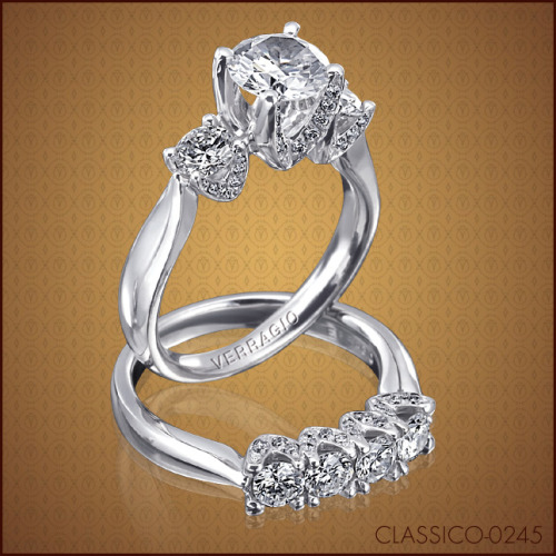 Traditional look of the three-diamond engagement ring has been refined and enhanced with the additional pave' set diamonds on the Classico-0245 design, pictured here with its matching wedding band Classico-0245W.