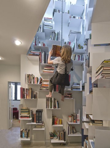 I need this so badly.  iheartclassics:  A book shelf for the most avid of readers…you don't even have to move to start reading!