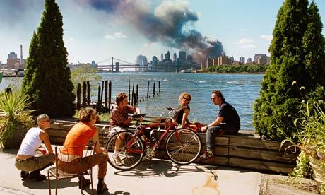 "via The Guardian - Thomas Hoepker's photo of New Yorkers apparently relaxing as the twin towers smoulder says much about history and memory  ↑ click for link ↑ Ten years on, this is becoming one of the iconic photographs of 9/11, yet its history is strange and tortuous. Hoepker, a senior figure in the renownedMagnum photographers' co-operative, chose not to publish it in 2001 and to exclude it from a book of Magnum pictures of that horribly unequalled day. Only in 2006, on the fifth anniversary of the attacks, did it appear in a book, and then it caused instant controversy. …Walter Sipser, identifying himself as the guy in shades at the right of the picture, said he and his girlfriend, apparently sunbathing on a wall, were in fact ""in a profound state of shock and disbelief"". Hoepker, they both complained, had photographed them without permission in a way that misrepresented their feelings and behaviour. Well, you can't photograph a feeling. But another five years on since it surfaced in 2006, it seems pointless to argue about the morality of the people in the picture, or of the photographer, or his decision to withhold the picture from publication. It is now established as one of the defining photographs of that day – with the 10th anniversary of the World Trade Centre's destruction approaching, the Observer Review republished it this August as the 9/11 photograph."
