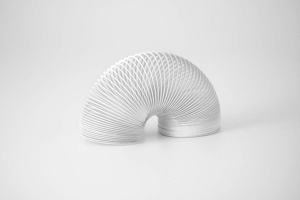 24/100: Slinky brandspirit is a project where every day for 100 days, Andrew Miller will paint one branded object white, removing all visual branding, reducing the object to its purest form.