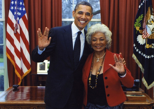 tpmmedia:  Appealing to the always important Trekkie voter base, Obama throws up the Vulcan salute with Nichelle Nichols, Star Trek's Uhura.  Now that's pretty bad ass.