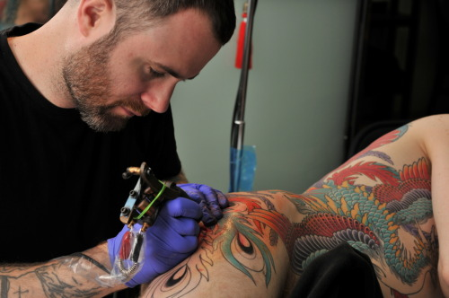 Chris O'Donnell tattooing David Hines at Saved Tattoo, New York. Photo by Andrew Hines