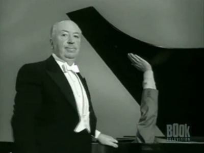 Pictured above: Sir Alfred Hitchcock, holding his grand piano open with a dead guy's arm.
