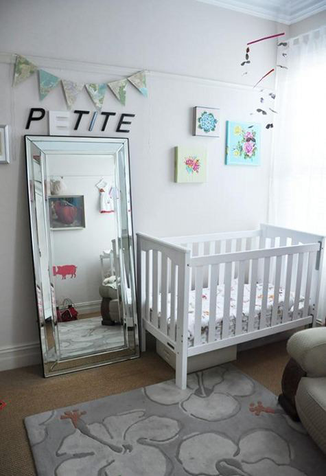 The wall canvasses in this classy, light and airy nursery are made from vintage table cloths stretched over frames. Here are 21 inspiring baby rooms from around the web, from vintage-cool to ultra mod.