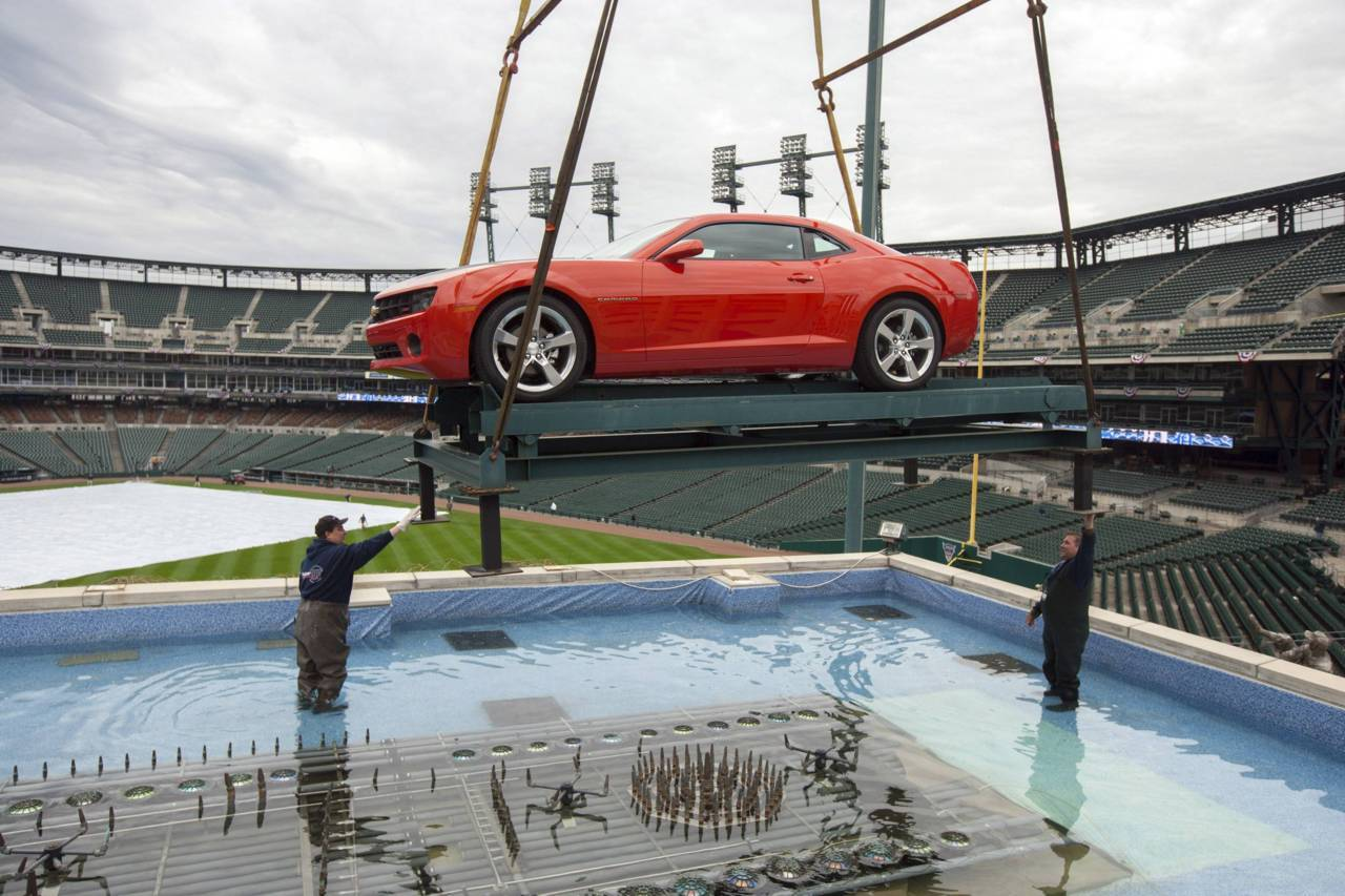 A Chevrolet Camaro is positioned on its platform in the Chevrolet Fountain in centre field at Comerica Park in Detroit, Michigan. A Chevrolet Malibu Eco was also positioned in the fountain in time for the Detroit Tigers' Opening Day MLB baseball festivities on April 4 when they will host the Boston Red Sox.