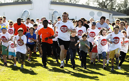 PM running the Sport Relief Mile 2012 Prime Minister David Cameron (centre), accompanied by his wife Samantha (behind right), starts a mile run for Sports Relief charity at a sports field outside Great Missenden in Buckinghamshire. (Photo via The Prime Minister's Office)