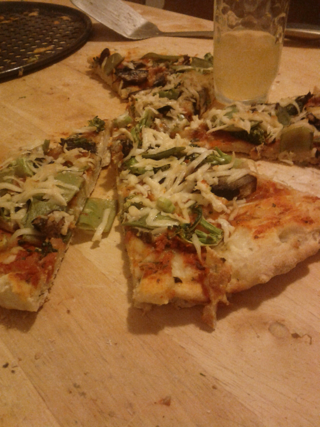 vegan pizza! harvested some dill from my front stoop container garden for the crust, used basil and sun dried tomato marinara for sauce, added portobello mushroom, broccoli and snow peas, then topped it off with Follow Your Heart vegan cheesee! YUM!