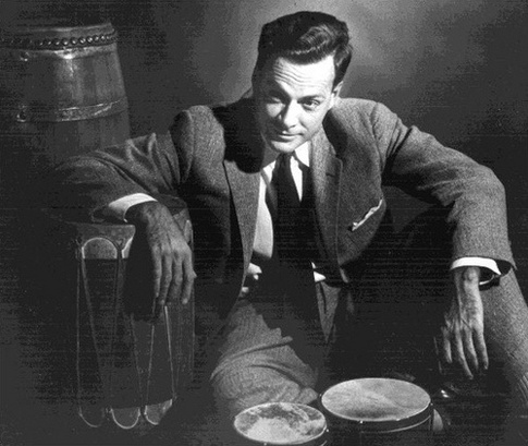 "Theoretical Physicist Richard Feynman with His Drums     Uncredited and Undated Photograph ""Electrons, when they were first discovered, behaved exactly like particles or bullets, very simply. Further research showed, from electron diffraction experiments for example, that they behaved like waves. As time went on there was a growing confusion about how these things really behaved —— waves or particles, particles or waves? Everything looked like both. This growing confusion was resolved in 1925 or 1926 with the advent of the correct equations for quantum mechanics. Now we know how the electrons and light behave. But what can I call it? If I say they behave like particles I give the wrong impression; also if I say they behave like waves. They behave in their own inimitable way, which technically could be called a quantum mechanical way. They behave in a way that is like nothing that you have seen before. Your experience with things that you have seen before is incomplete. The behavior of things on a very tiny scale is simply different. An atom does not behave like a weight hanging on a spring and oscillating. Nor does it behave like a miniature representation of the solar system with little planets going around in orbits. Nor does it appear to be somewhat like a cloud or fog of some sort surrounding the nucleus. It behaves like nothing you have seen before. There is one simplication at least. Electrons behave in this respect in exactly the same way as photons; they are both screwy, but in exactly in the same way…. The difficulty really is psychological and exists in the perpetual torment that results from your saying to yourself, 'But how can it be like that?' which is a reflection of uncontrolled but utterly vain desire to see it in terms of something familiar. I will not describe it in terms of an analogy with something familiar; I will simply describe it. There was a time when the newspapers said that only twelve men understood the theory of relativity. I do not believe there ever was such a time. There might have been a time when only one man did, because he was the only guy who caught on, before he wrote his paper. But after people read the paper a lot of people understood the theory of relativity in some way or other, certainly more than twelve. On the other hand, I think I can safely say that nobody understands quantum mechanics. So do not take the lecture too seriously, feeling that you really have to understand in terms of some model what I am going to describe, but just relax and enjoy it. I am going to tell you what nature behaves like. If you will simply admit that maybe she does behave like this, you will find her a delightful, entrancing thing. Do not keep saying to yourself, if you can possible avoid it, 'But how can it be like that?' because you will get 'down the drain', into a blind alley from which nobody has escaped. Nobody knows how it can be like that.""  Richard P. Feynman, The Messenger Lectures, MIT, 1964"