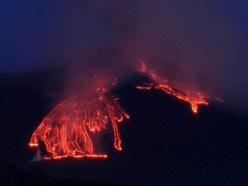 mothernaturenetwork:  Photo of the day: Rivulets of fire and ashBright neon orange streams of lava pour down the side of Mount Etna just before dawn on April 1. The fiery episode, which is the 23rd of its kind since January 2011, lasted for an hour and a half.