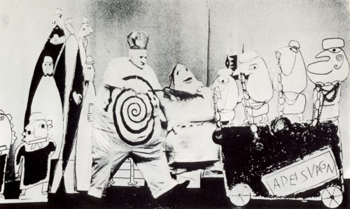 cross-my-tea:  triste-le-roy:  Photograph of stage performance of Alfred Jarry's Ubu Roi (by Marionette Theater Stockholm; Michael Meschke, Sture Pyk, & Franciszka Themerson; music by Krzysztof Penderecki, 1964—photographer unknown?). (via Chaudron)  Amazing.  I love the combination of three-dimensional and two-dimensional elements.