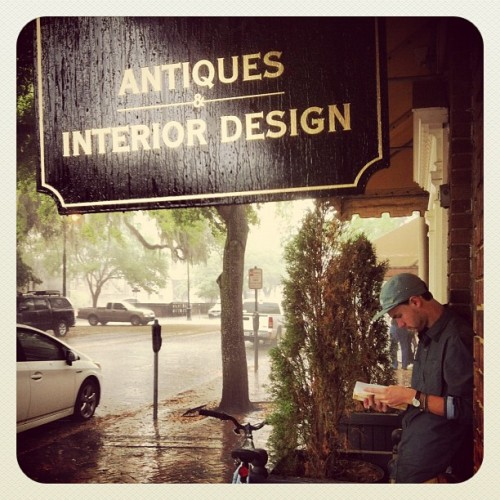 Getting Caught in a Rain Storm Savannah #savannah #georgia #rain #bike #book #waiting  (Taken with instagram)