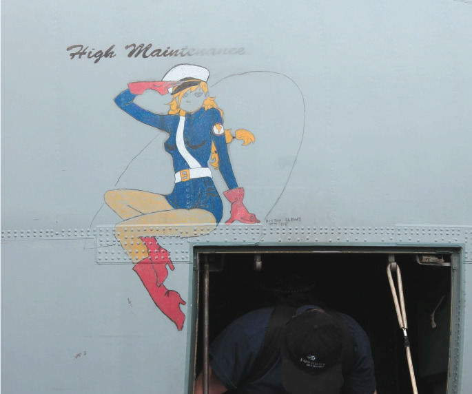 "Pin up Plane Art - reads ""High Maintenance""."