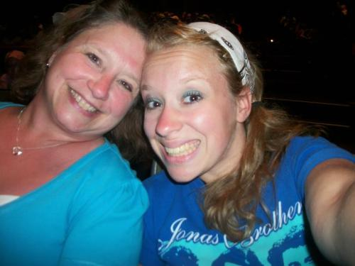 Me and my mama seeing Aladdin at California Adventure last summer! 2 months until I go again!<3