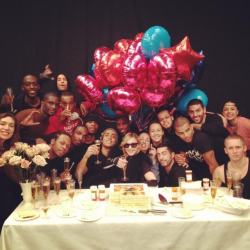 M celebrating MDNA going to #1 with her tour crew.
