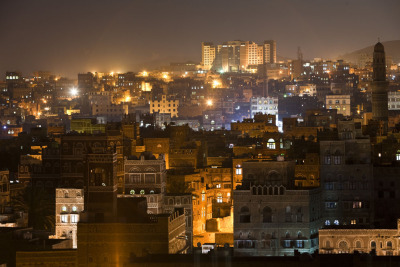 382 DAYS - 365 PHOTOS - Photo 346, taken March 8, 2012, Sana'a, Yemen. The ancient city of Sana'a at night. This is one of the world's oldest cities. Inside the narrow alleys of the old city people have been living continuously for thousands of years. Noah's son Shem is said to have started the city. 382 DAYS - 365 PHOTOS is a series of photographs from the archives of jonahkessel.com. Photographs span over eight years and include locations from all around the world. They fall in no particular order, but their own.  For an explanation of why there are 382 days in this photo series instead of the traditional 365 days, see this link. To make bets on how many days will actually pass by the time it takes Jonah to post 365 pictures, see this link.