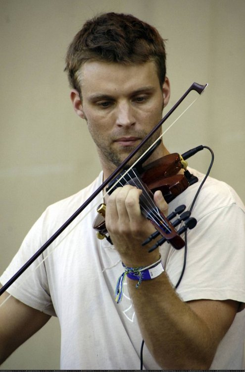 oursideofparadise:  Daily photo of JS playing the violin.  Did we mention that we, like, dodally, dig the kind of permanent bags under his eyes?