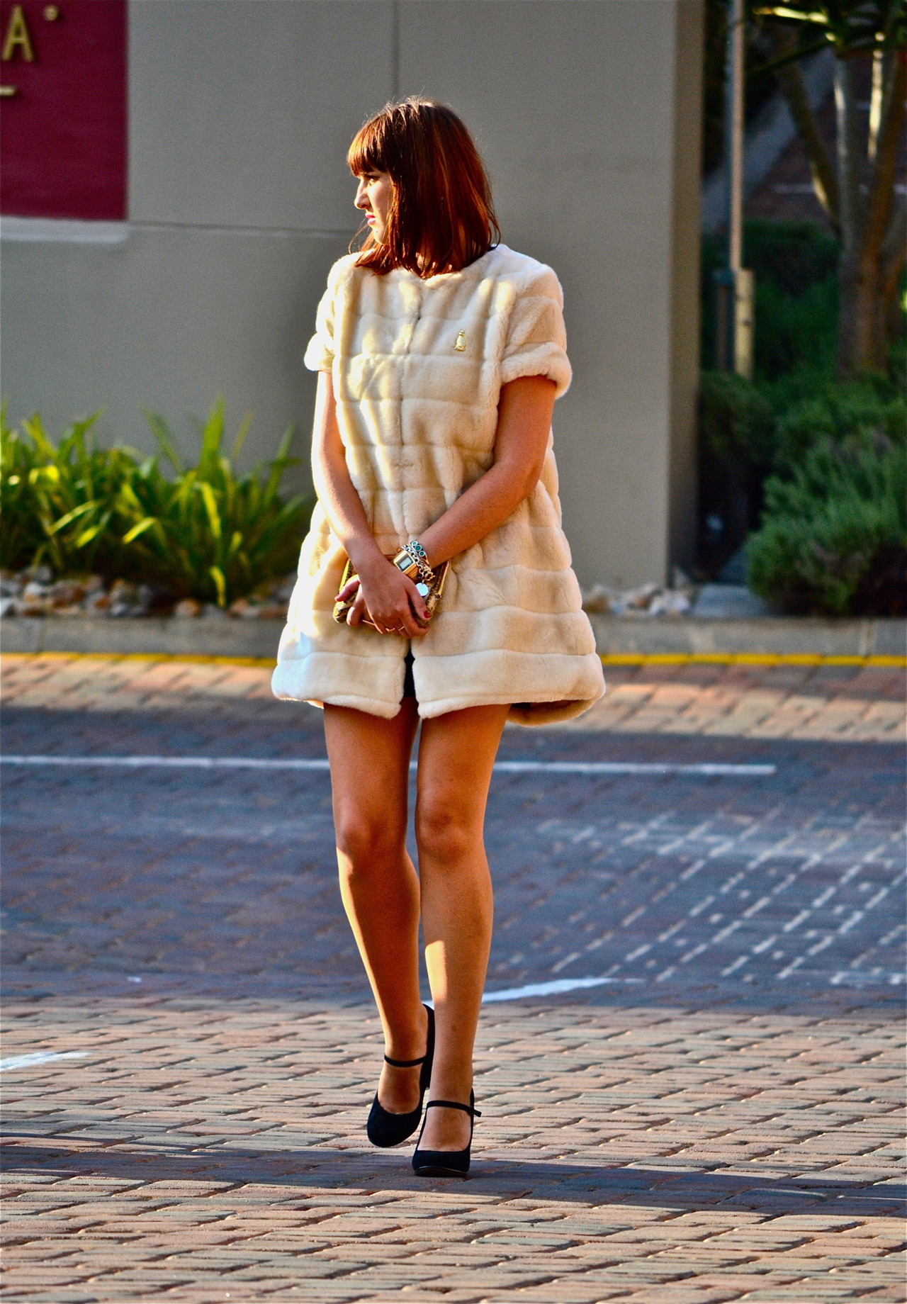 "SA FASHION WEEK | Street Style After a few days of contemplating whether or not to post these photographs I took on the last day of South Africa Fashion week, I thought,why not? I have to say in all honesty I was disappointed by what a lot of bloggers & publications covering the event deemed to be ""street style"". Isn't a prerequisite of said ""street style"" that it at least be taken outdoors? Anyway, I hope you enjoy the posts as much as I enjoyed taking them. Photographed by: The Expressionist"